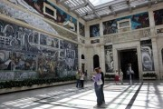 Visitors to the Detroit Institute of Arts look at the four-wall mural by famed artist Diego Rivera in Detroit, Michigan June 5, 2013.