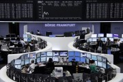 Shares, dollar sink as U.S. authorizes air strikes in Iraq