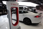 A Tesla S electric car and a charging station are displayed during the press preview day of the North American International Auto Show in Detroit, Michigan in this January 14, 2014 file photo.