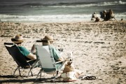Retirees Relaxing On The Beach