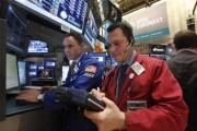 Traders work on the floor of the New York Stock Exchange, January 8, 2013