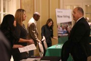 Job Seekers Look For Employment At Career Fair