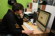 Teenager in his bedroom on a social networking site