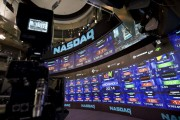 Stock prices are displayed in the studio at the Nasdaq Marke