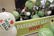 Members of the MEP greens party demonstrate in support of fully paid paternity leave