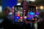 The new Windows Lumia 640 XL, left, and Lumia 640 smartphones