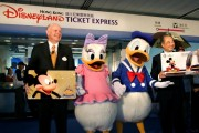Walt Disney characters Donald Duckwith Disneyland Don Robinson (L) and Chief Executive of the MTR Corporation C.K Chow (R)