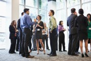 Cluster of attendees networking at conference