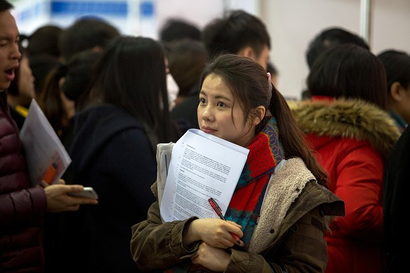 A young college graduate waits for submitting her resume