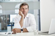 Bored and frustrated businessman at desk