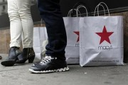 Customers stand outside Macy's store in New York, April 11, 2013. Credit: Reuters/Brendan McDermid