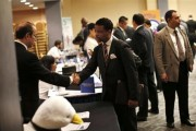 A job seeker (R) meets with a prospective employer at a career fair in New York City, October 24, 2012. Credit: Reuters/Mike Segar
