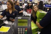 Wal-Mart Sales associates bring Xbox game console