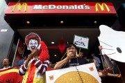 Activists stage a protest in front of a MacDonalds