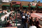 Hungry citizens line up for free burritos and other fare at the grand opening of a new Chipotle restaurant