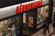 Shoppers passing by Aeropostale retail store inside a mall