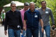 Tim Cook, chief executive officer of Apple Inc.with Leslie 'Les' Moonves, president and chief executive officer of CBS Corp