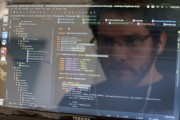 Man uses a computer to write code that would allow people living in Cuba to use email to post to blogs.