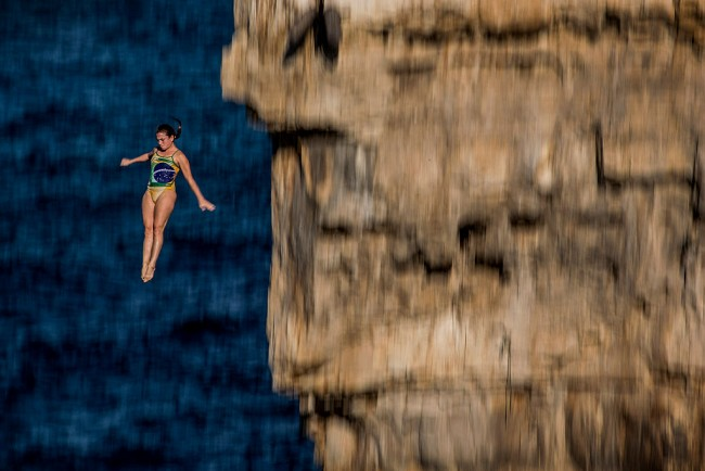 Fearless Jacqueline Valente of Brazil dives from a 22 metre platform in Italy