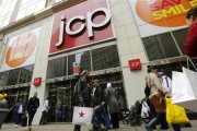 A man with a Macy's bag walks past the J.C. Penney's store in New York, April 11, 2013. Credit: Reuters/Brendan McDermid