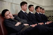 Man sleeping next to others