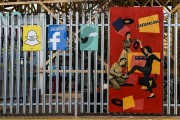 Snapchat, Facebook and Twitter signs under the wooden rollercoaster