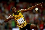 Usain Bolt of Jamaica celebrates after winning gold in the Men's 200 metres final