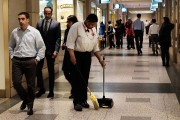 A woman sweeps the floor at Rockefeller Center