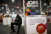 A job-seeker completes an application at a career fair held by civil rights organization National Urban League as part of its annual conference, in Philadelphia July 25, 2013.