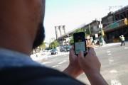 NEW YORK, NY - AUGUST 04: A man catches Pokemon near the Brooklyn Bridge as the Pokemon Go Craze Hits New York City on August, 4 2016 in New York City.