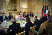 French President Francois Hollande Receives German Federal Chancellor Angela Merkel At Elysee Palace In Paris