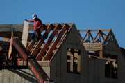 Construction Worker Works on Housing Project