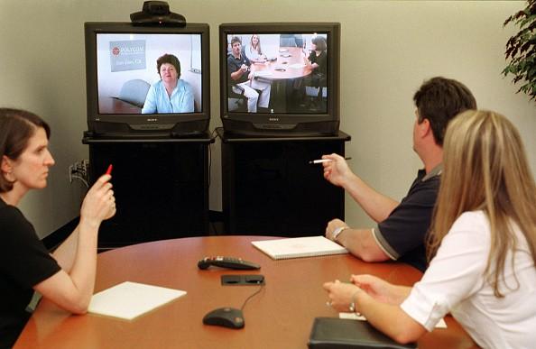 Polycom employees use videoconference system