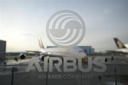 An A380 aircraft is seen through a window with an Airbus logo during the EADS / Airbus 'New Year Press Conference' in Hamburg January 17, 2012.